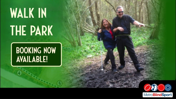 Photo of a guide and walker laughing out loud together as they go over a muddy path text says Walk in the Park- Booking Now Availabl
