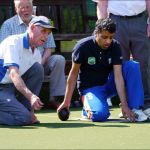 Hassan being taught by Eric at Walthamstow Borough Bowling Club