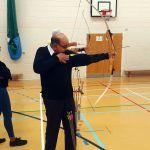 VI archer lining up shot