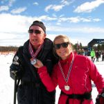 Look I have a medal- guide holds up skier medal - Norway 2011