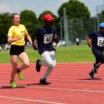 Side on Photo of Under 18 Track event with guide