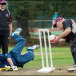Batsman dives for the line as wicket keeper hit the strumps in a T20 Final