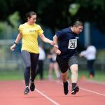 100m. Junjie Xu with guide runner