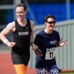 5000m. Maya-Liam Haynes with guide runner