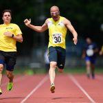100m. Amir Kamali-Sarvestani with guide runner