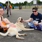 Guide dog enjoying owner and guides attention