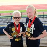 Brother and Sister with all their medal pose for their photo medals