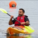 Smiling while Solo kayaking in a life jacket