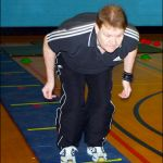 Warm up exercises on a marked out mat